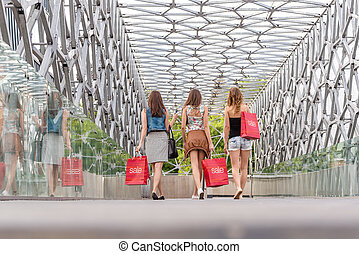 3 Pretty woman walking on the bridge, they go shopping - back photo