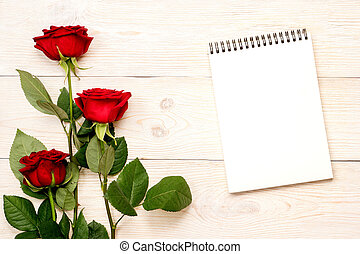 3 red roses, notebook