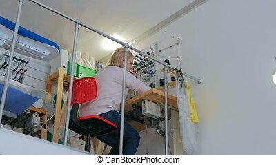 3 shots. Professional fashion designer working at sewing studio