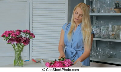 3 shots. Professional floral artist sorting flowers - pink peonies at studio