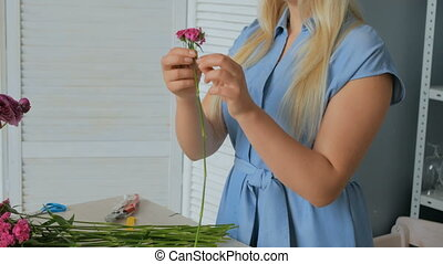 3 shots. Professional floral artist working with flowers at studio