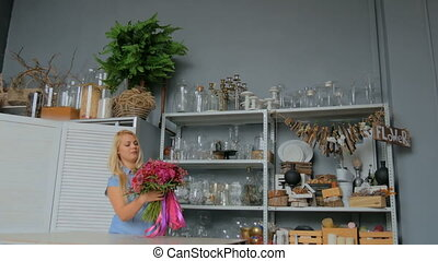 3 shots. Professional florist holding and checking bouquet at studio