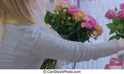 3 shots. Professional florist making beautiful bouquet at flower store