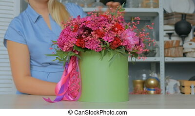 3 shots. Professional florist showing bouquet at studio