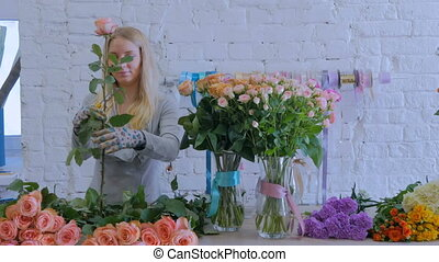 3 shots. Professional florist working with flowers at studio