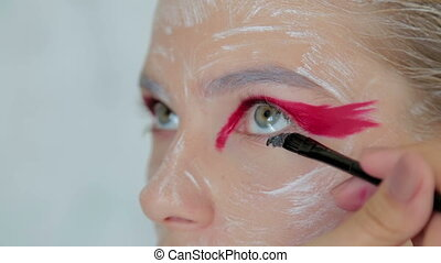 3 shots. Professional make-up creating face makeup art