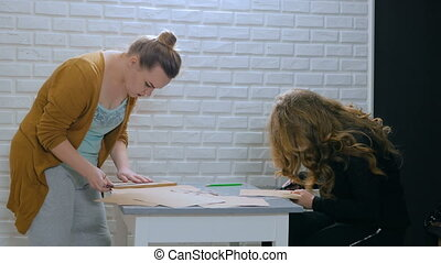 3 shots. Two professional women decorators, designers making...