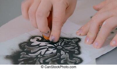 3 shots. Two women decorators, designers painting wooden...