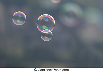 3 soap bubbles on gray background