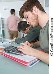 3 students in classroom