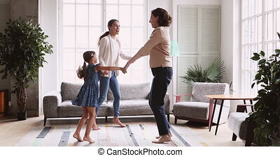 3 three age generations women family dancing in living room