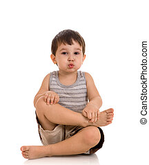 3 years old boy relaxing on white background