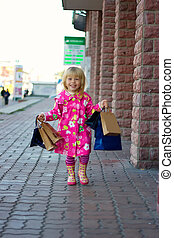 3 years old girl down the street with shopping