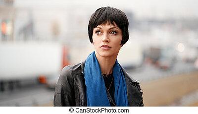 30 years old pretty brunette woman in a city street. Outdoors portrait