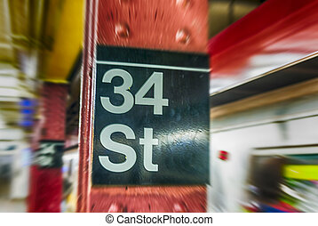 34th street sign in New York CIty subway