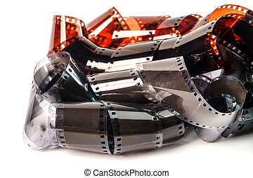 35 mm photo film. Old photo film negative isolated on white. Photographic film strip isolated on white background. Black and white with color film.