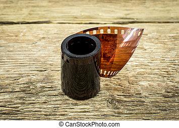 35mm negative films on wooden background