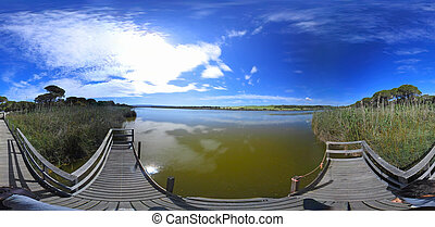 360 degrees view of Platamona pond on a sunny day in springtime