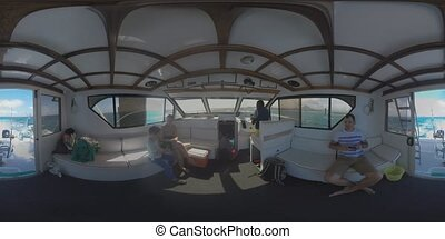 360 VR Family traveling by yacht. Inside view with captain...