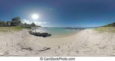 360 VR View of ocean and coast with cottages in Mauritius. Family on the beach
