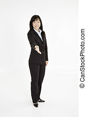 Beautiful Asain Businesswoman reaching out to shake hands on a white background
