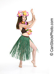 Eight year girl dressed in an Hula Dancers outfit on white background