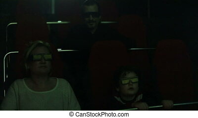 3D - 5D movie - time lapse, family watching 5D movie