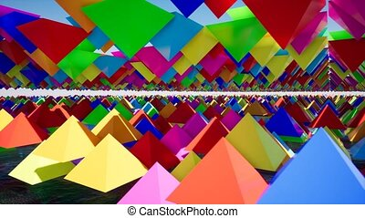 3D animation of abstract floating triangles in bright colors.