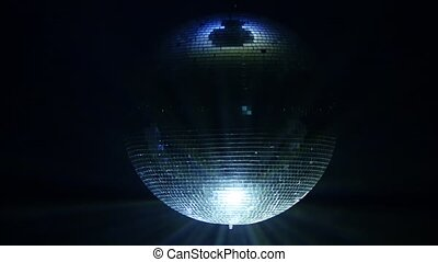 3D Disco mirror ball reflecting colorful lights smoke on black background