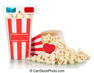 3D glasses, boxes popcorn and spilled red heart on white.