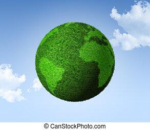 3D green grass globe on a blue sky