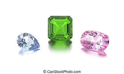 3D illustration closeup group of three different blue, green, pink diamonds