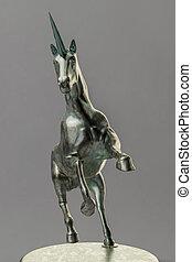 a beautyful bronze unicorn figure isolated on gray background