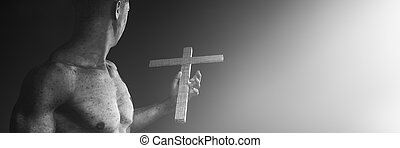 man holding a wooden cross