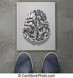 3d metal human brain icon on front of business man feet as concept