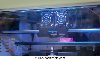 3D printer during work - Three dimensional printer during...