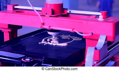 3D printer printing pancakes with liquid dough different shapes close-up.