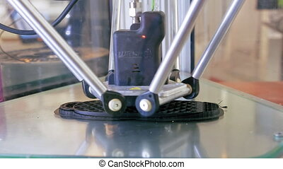 3D printer performs product creation. Modern 3D printing or...