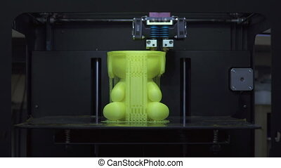 3D printer prints detail - The process of printing on a 3D...