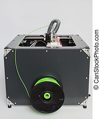 3d printer with bright green filament.