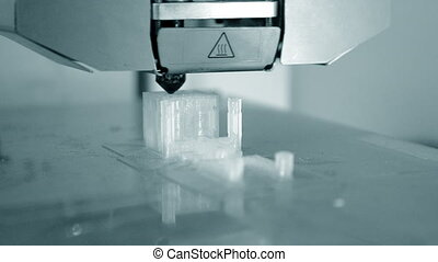 3D printer working. Fused deposition modeling, FDM. 3D...