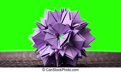 3d purple origami spiky ball exposition. Green hromakey...