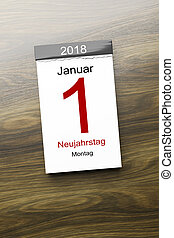 a calendar the 1st of January new year day text in german language
