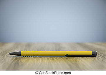 a yellow pen and lots of space for your content