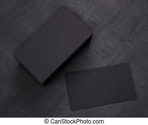 3D rendering of business card. Blank template black Business Cards on black wooden background. Top view.