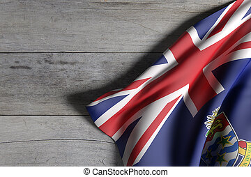 Cayman Islands flag over a wooden surface