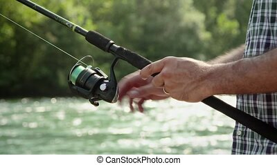 3of8 Man with fishing rod on river