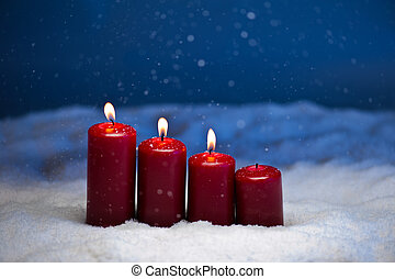 3rd Advent candles in snow and snowfall