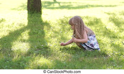 3s Happy girl picking flowers in th