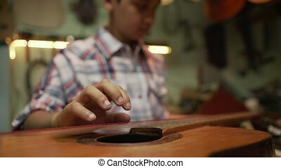 4-Boy Tuning Classic Guitar In Lute Maker Shop